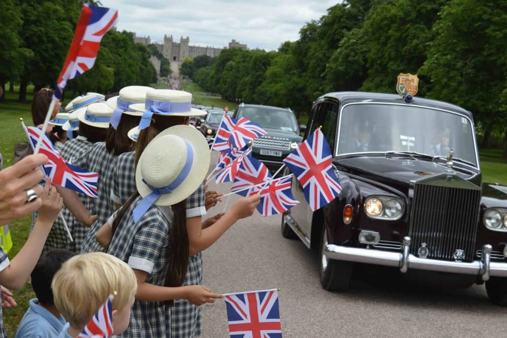 Upton House School Windsor kids on Long Walk waving union jacks as queen tdrives past inn car from Windsor Castle