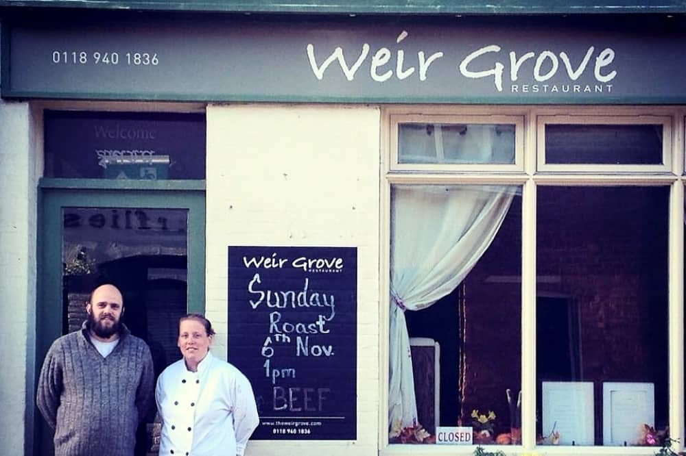 Weir grive restaurant Wargave sage green sign large windows owners stood outside