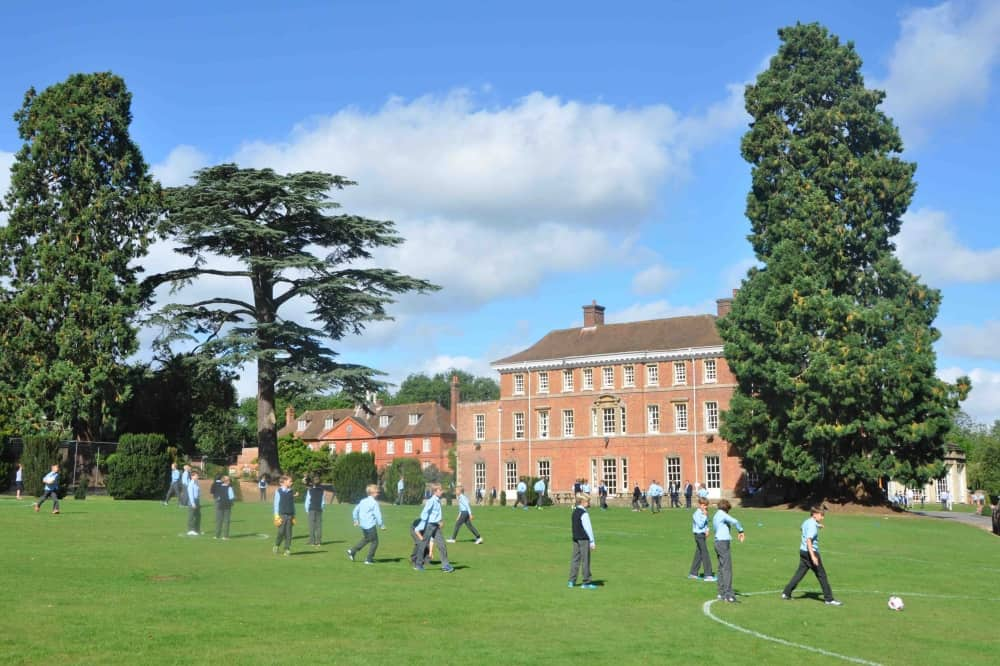 Elstree School Woolhampton Berkshire boys playing in front of grade ii list red brick georgian mansion