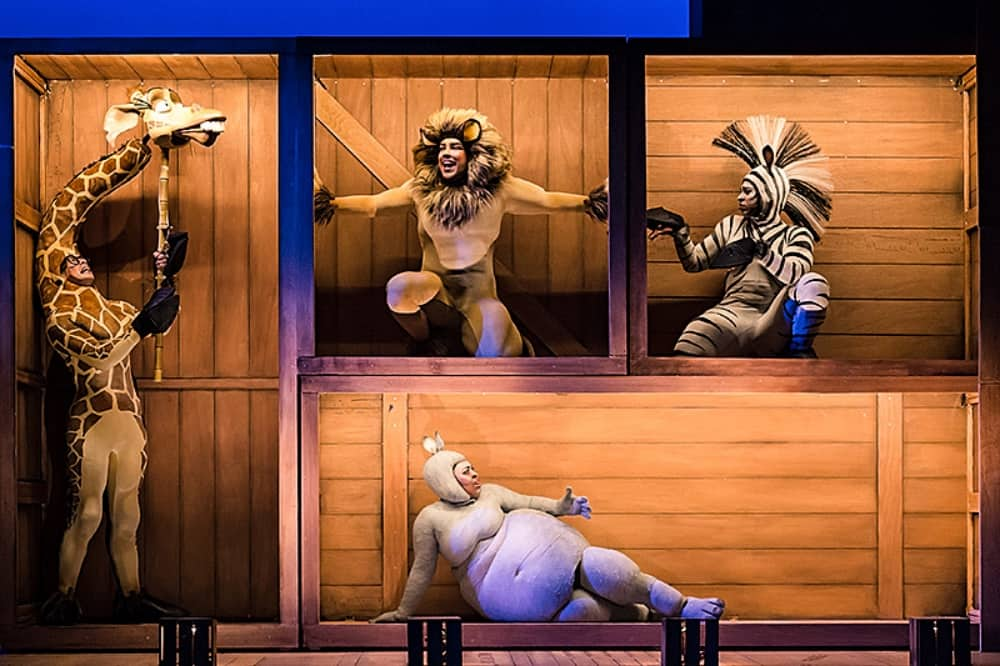 madagascar The Musical wooden crate on stage with giraffe lion hippo annd zebra inside