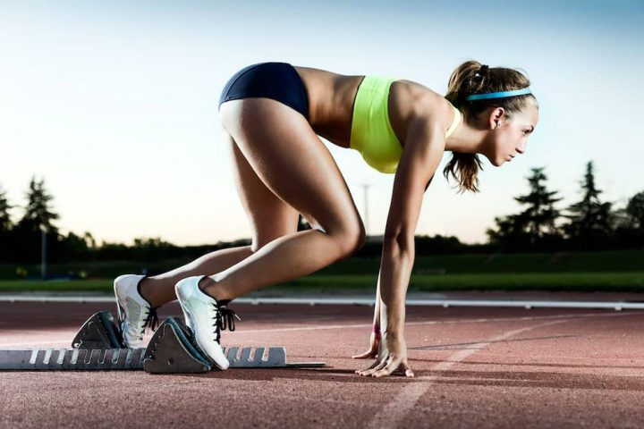 woman coming out of the starting blocks running