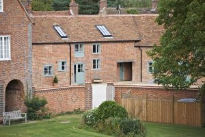 red brick sage green woodwork grade II listed cottages Manor Farm Courtyard Cottages