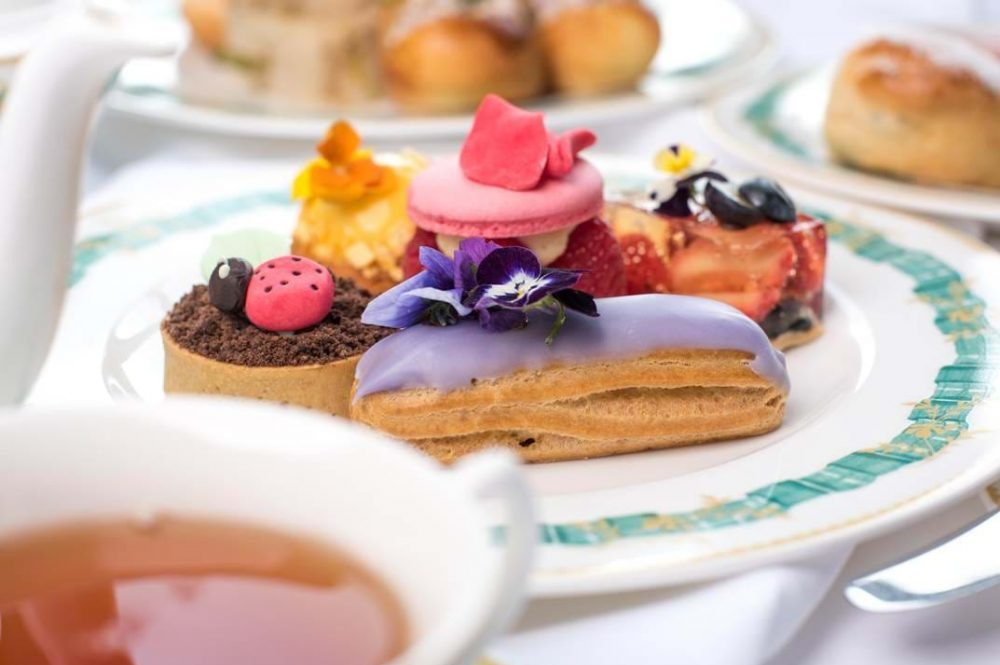 colourful cake and pastries on white and green Cliveden House Hotel china afternoon tea