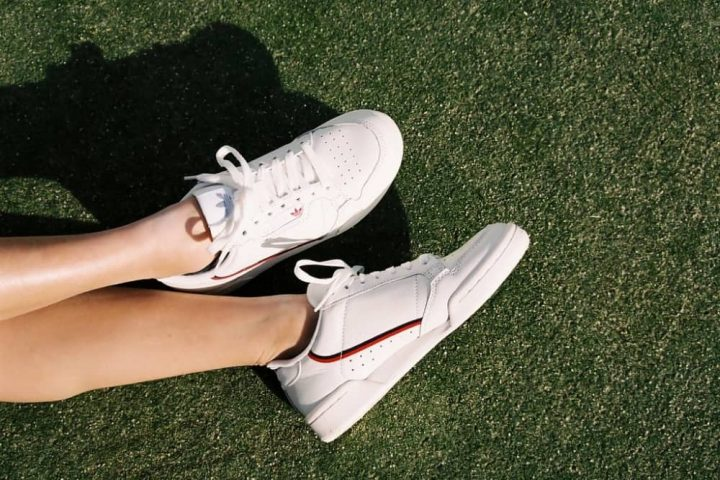 Adidas Continental 80 white trainers on grass court