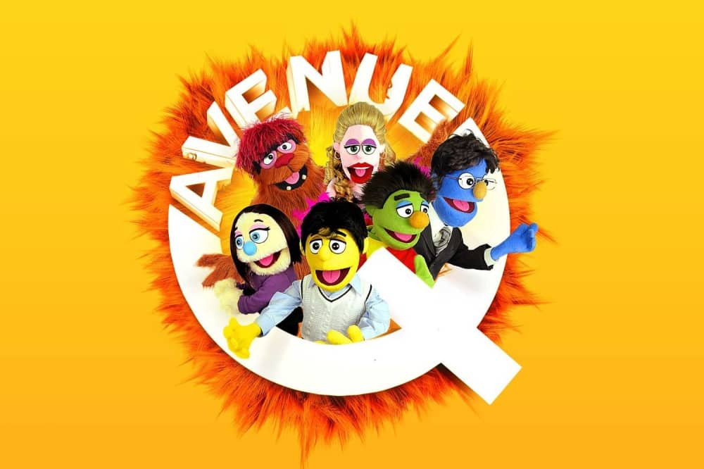 Avenue Q puppets inside fuzzy q yellow background