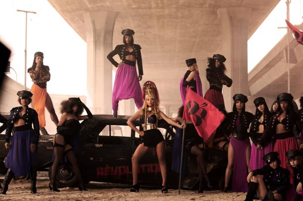 Beyonce video Who runs The World GIRLS car dancers on car and beyonce in military costume