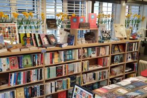 The Little Bookshop Cookham Berkshire shelved of books and table displays inside