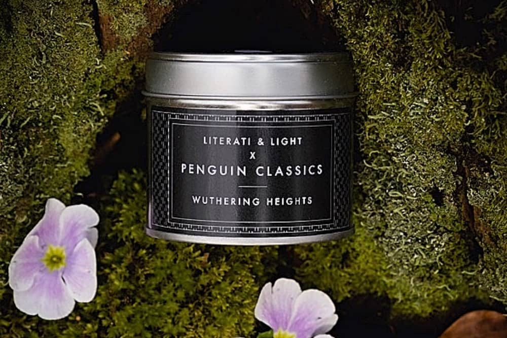 Metal candle tin on moss with flowers Literati and Light Penguin Classic candle