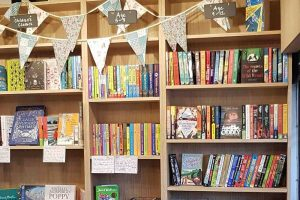 The little Bookshop Cookham Berkshire kids section of book with bunting
