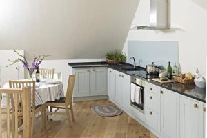 Manor Farm Courtyard Cottages Hampstead Norreys Berkshire L shaped shaker kitchen wooden floors dining table