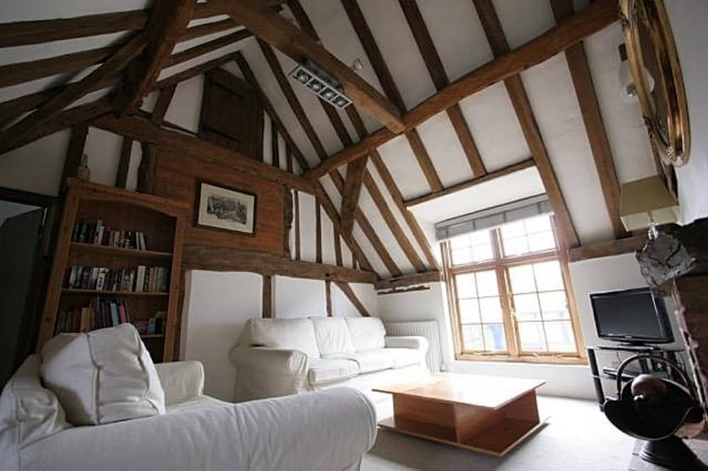 Old Butcher's Wine Cellar exposed beams vaulted ceiling cream sofa and wooden furniture cookham berkshire