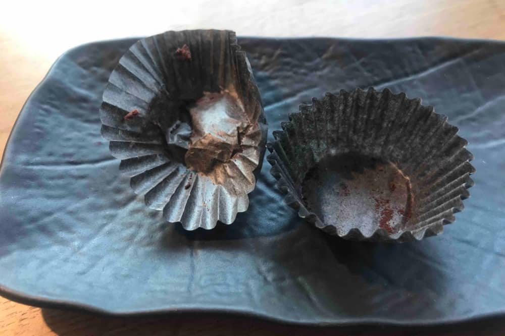 Roux at Skindles maidenhead Berkshire Chocolate Truffles empty wrappers ion textured charcoal plate
