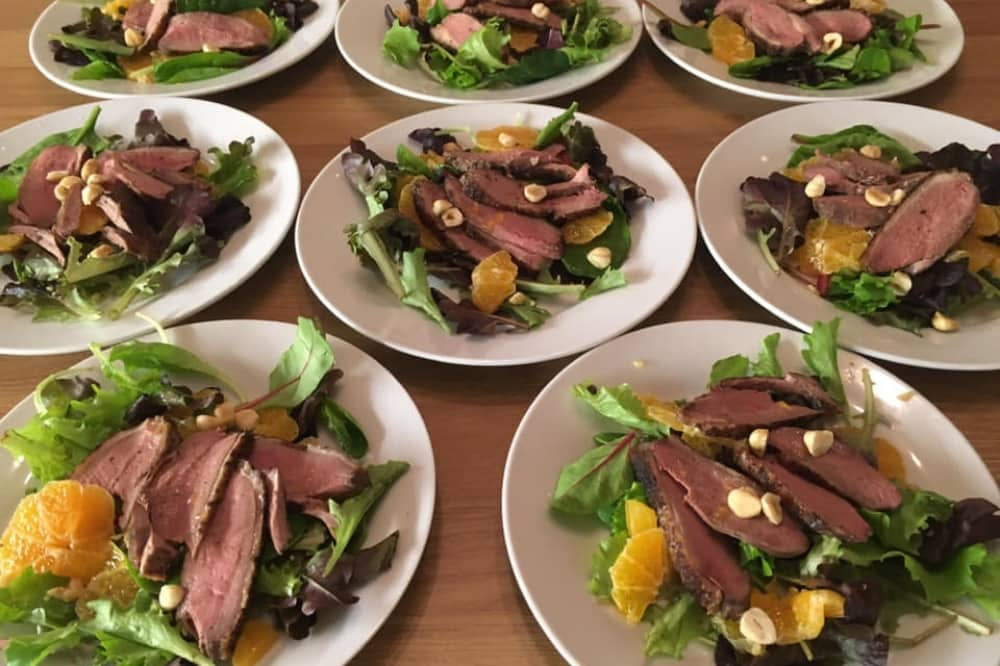 Sandhurst Supper Club plates of meat with lettuce and nuts