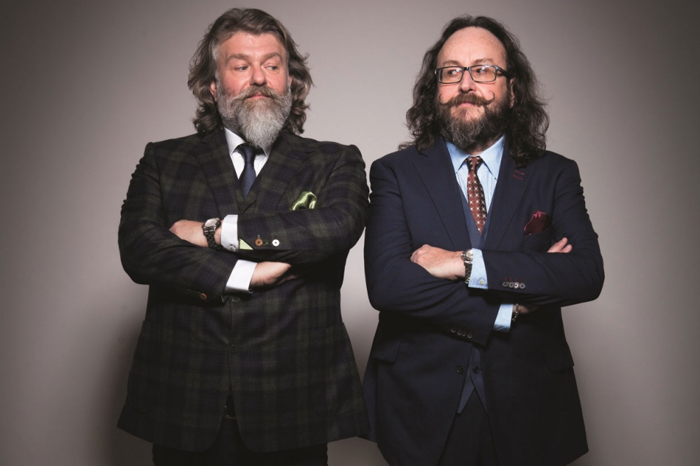 Hairy Bikers suited arms crossed long hair and beards touring chef talks