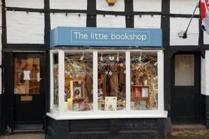The Little Bookshop Cookham Tudor white and black frontage with blue sign