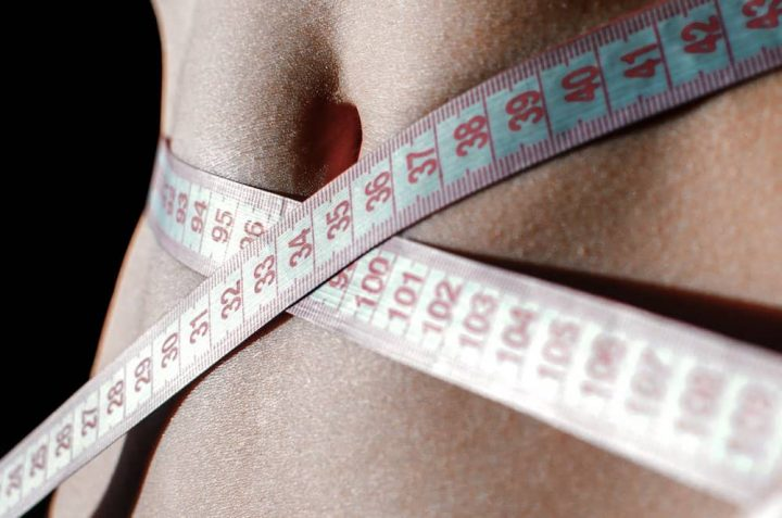 weight loss measuring tape around tummy