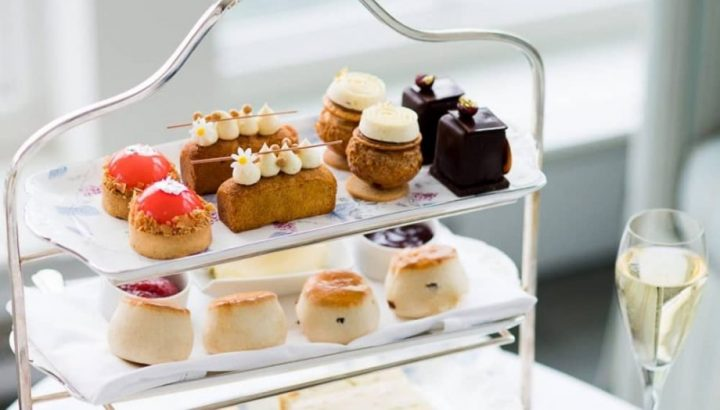 Coworth Park Ascot Berkshire afternoon tea served on silver cake stand in Drawing Room