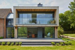 Absolute Architecture Newbury contemporary design wooden extension with floor to ceiling glass