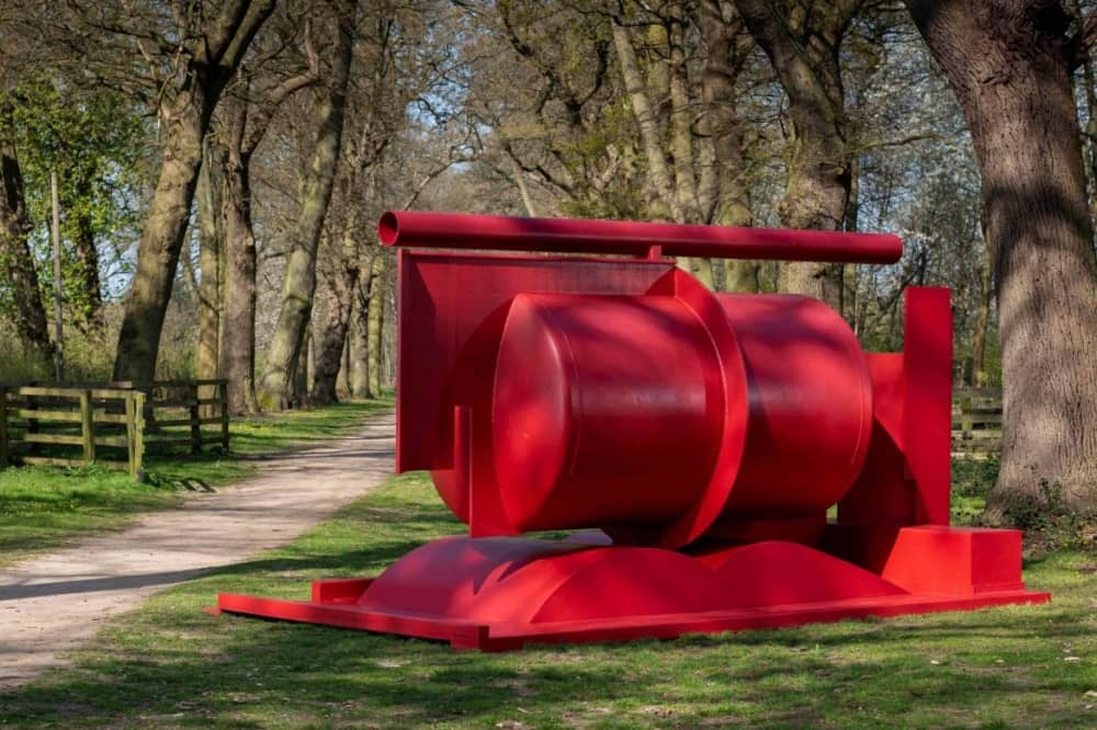 Anthony Caro Cliveden National Trust red industrial sculpture on woodland walk