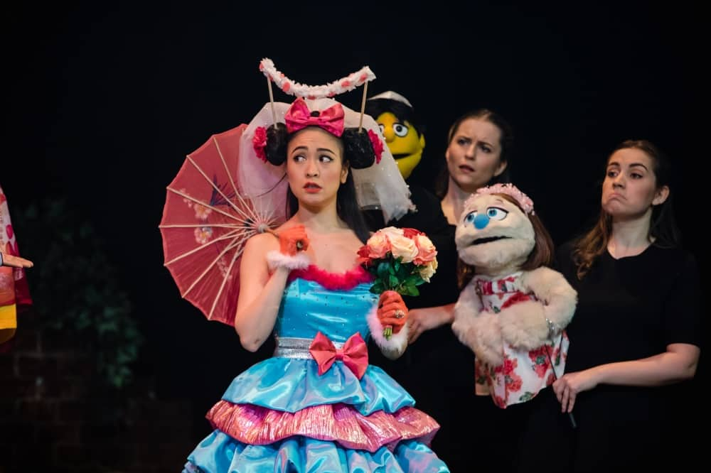 Avenue Q Christmas Even played by Soari Oda on her wedding day with Kate Monster and puppet handlers