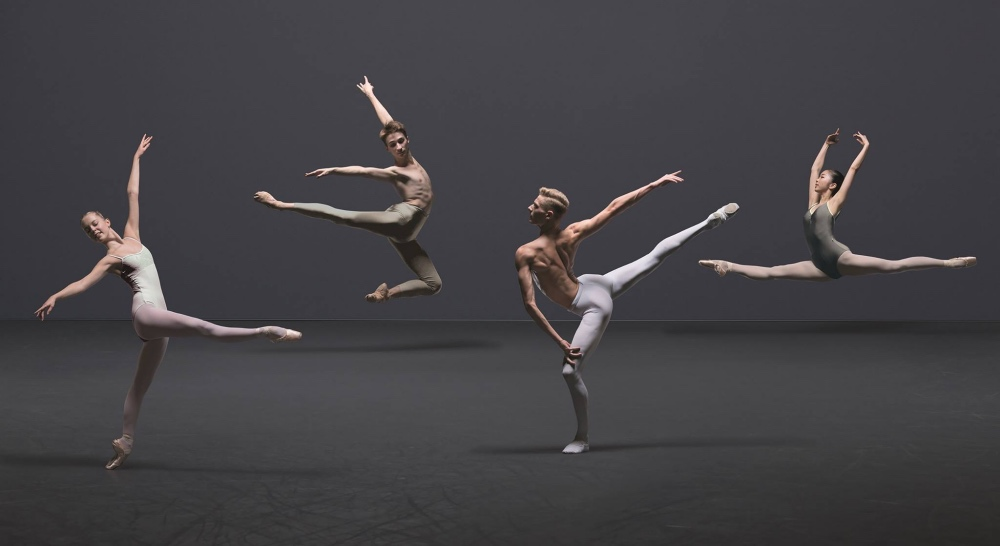 Ballet Central dancers in tights leap and standing with full leg extensions