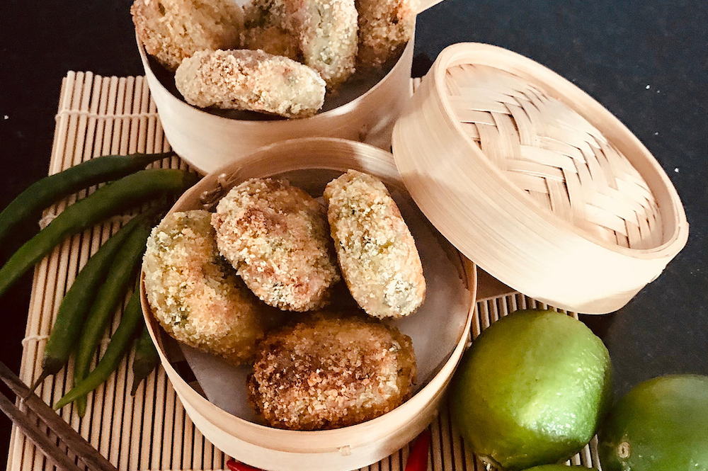 Canapes served in bamboo steamers with limes
