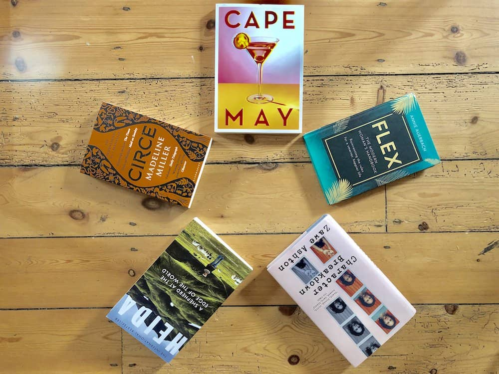 five new book releases shot on wooden floor in circle