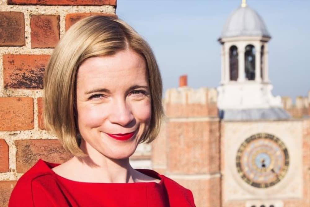 Historian Lucy Worsley blonde bobbed hair and red top