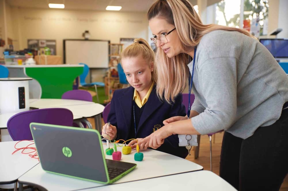 The Marist Ascot Berkshire girl with teacher usiing laptop and tech science blocks