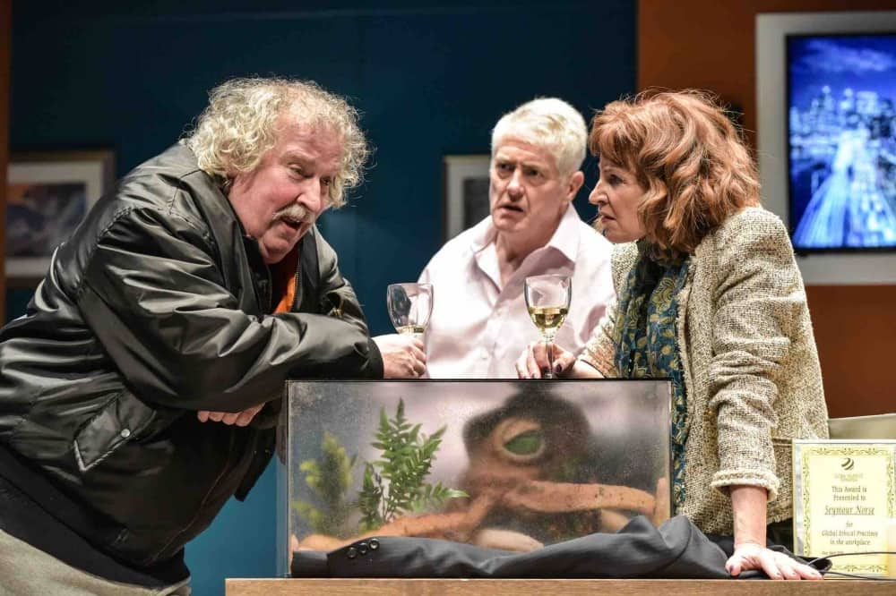 Octopus Soup Windsor Theatre Royal 2 men and 1 woman drink wine with an octopus in a tank