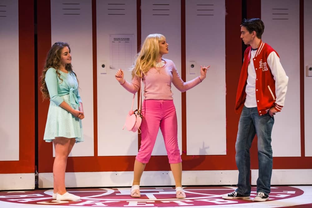 High School musical stage musical South Hill Park Bracknell Troy varsity jacket and jeans, gabriella mint mini dress and sharpay in pink