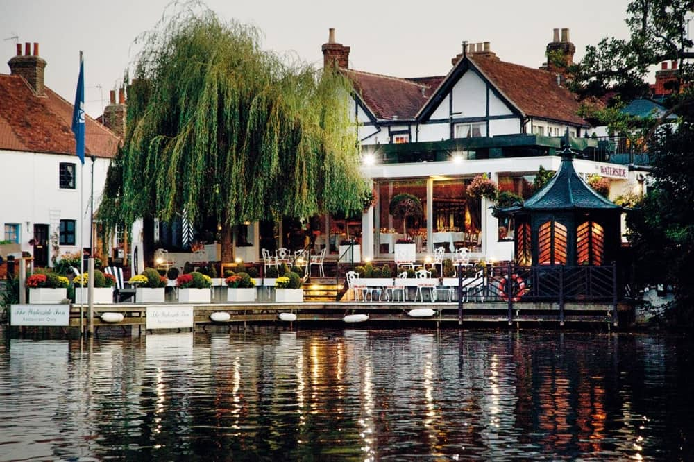 The Waterside Inn Bray Roux Berkshire restaurant 3 Michelin Stars white and black building jetty weeping willow outdoor tables and chairs