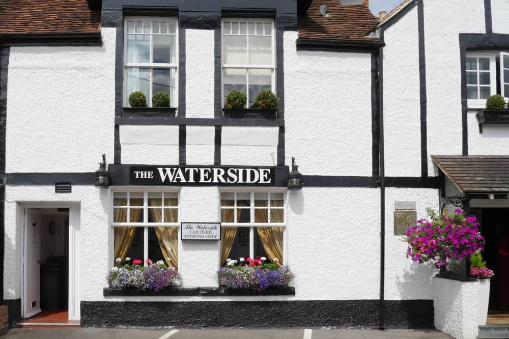 Waterside Inn 16th century white black building in Bray Berkshire