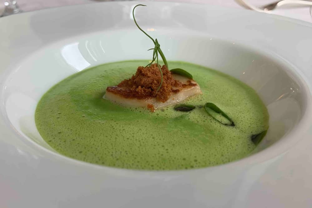Waterside Inn Bray starter Peat and mint soup scallop pea shoot white bowl
