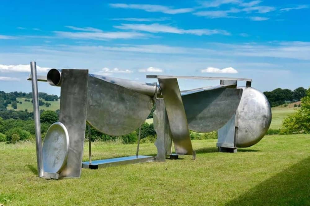 Anthony caro abstract steel sculpture on grassy hill