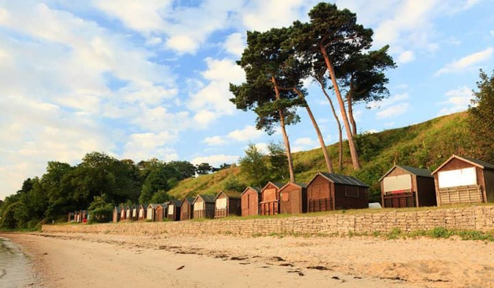 South beach Studland bay golden sand beach huts trees