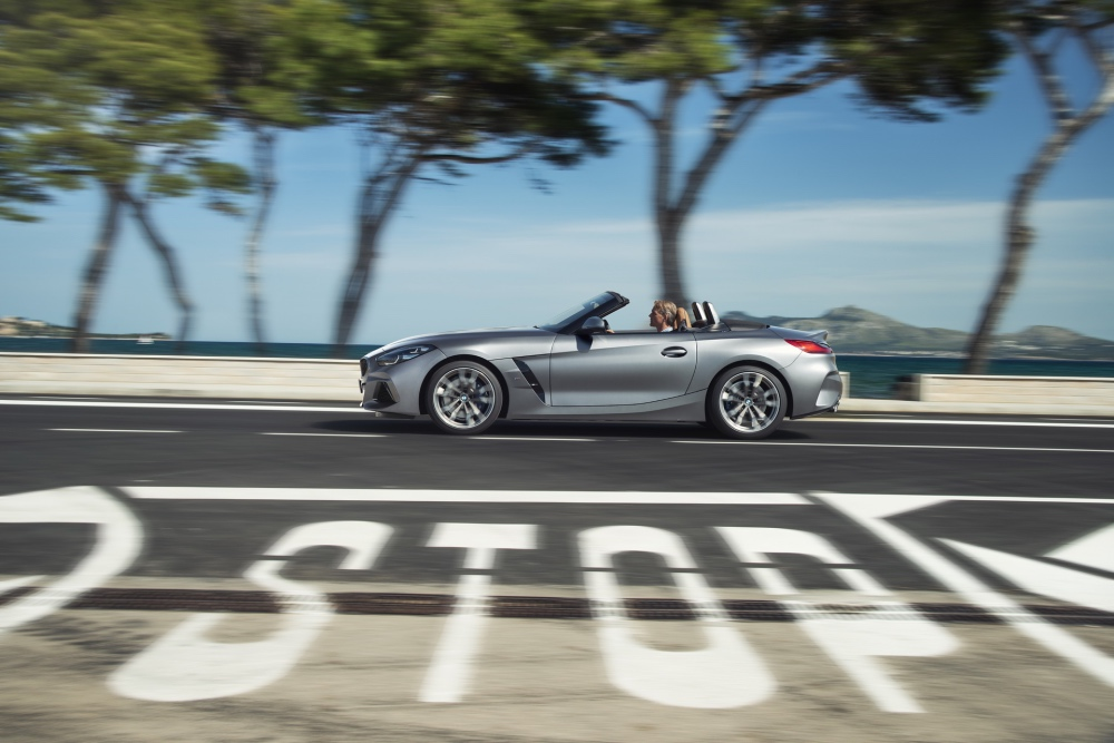 BMW Z4 2019 silver on road past stop sign