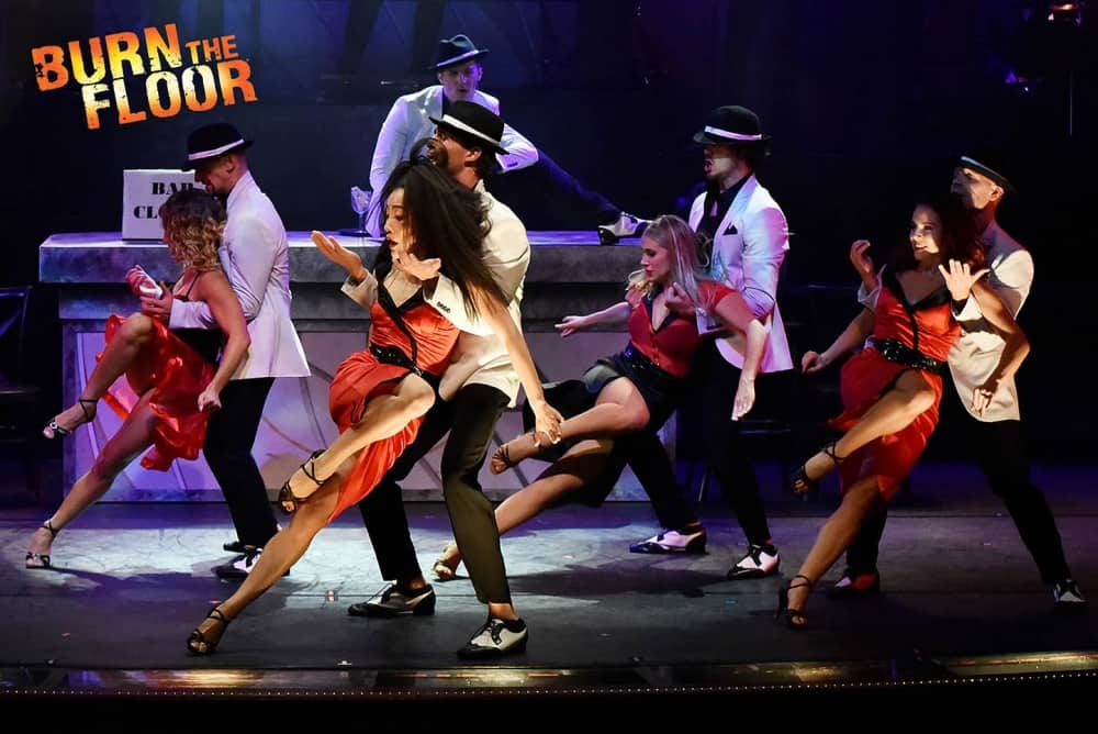 Kevin Clifton's BUrn The Floor dance show sancers in gangsters and molls outfIts on stage