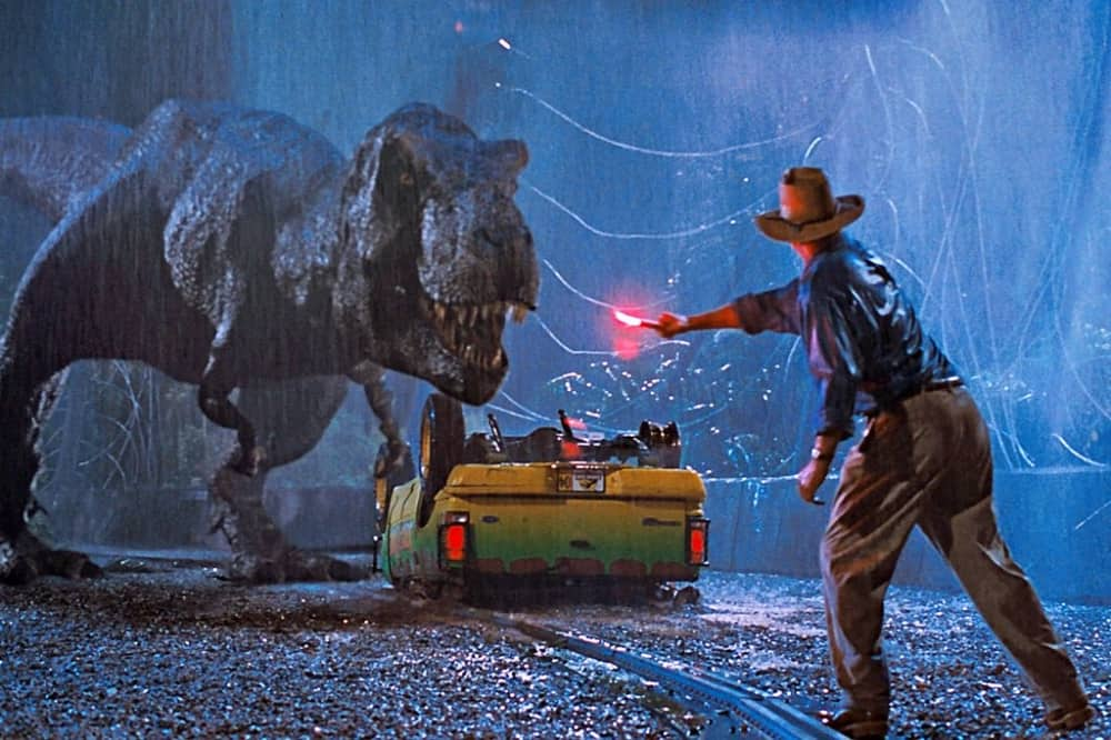 Jurassic Park Steven Spielberg film t rex smashed car and man with red light