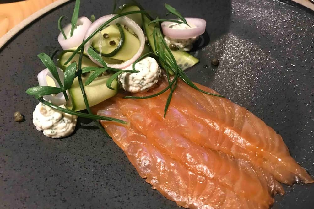 Monkey Island estate brasserie smoked salmon starter on grey plate