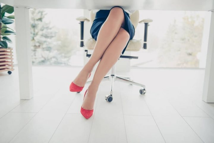 woman at desk in skirt