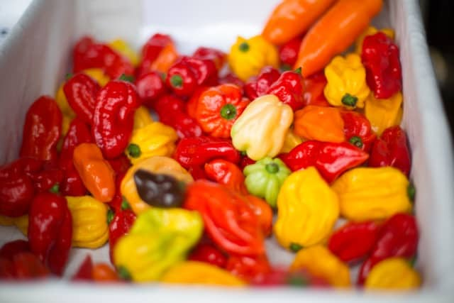 BOX OF RED Orange AND YELLOW chillies