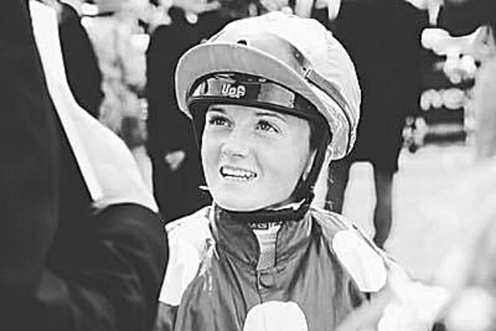 Black and and white image of Hollie Doyle in her jockey silks