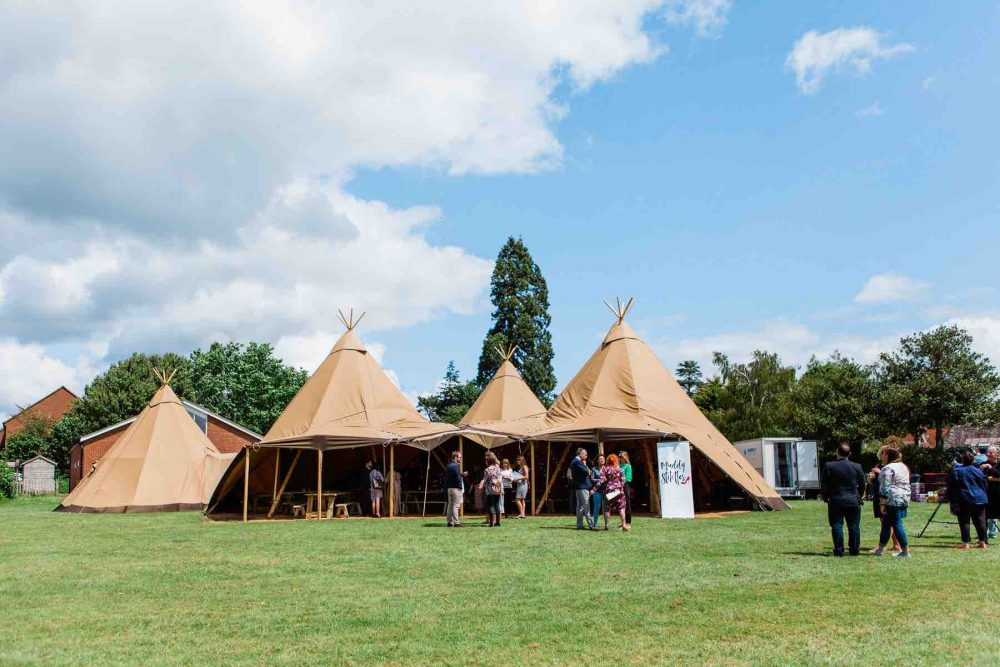 Muddy Stilettos Awards Forest Hedge Tipis Berkshire outdoor venue tipi tent in field