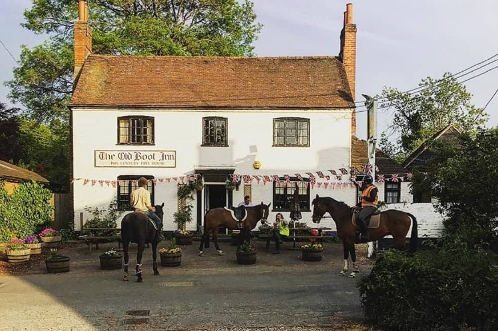 The Old Boot Stanford Dingley Berkshire white vitorian pub with horse riders visiting