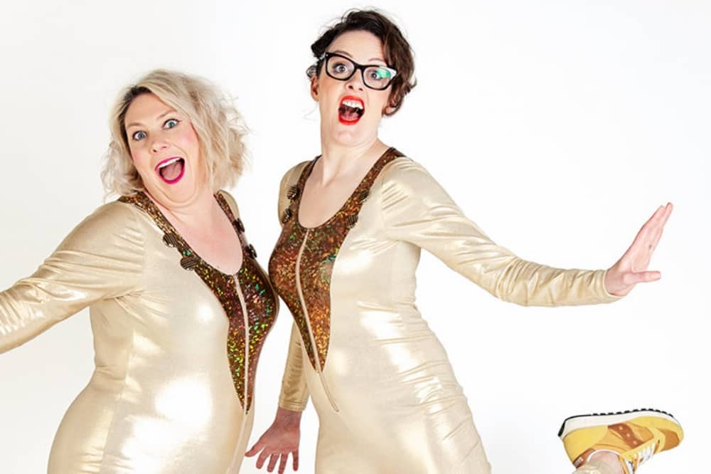 Comedy duo Scummy Mummies wearing gold all in one leotards