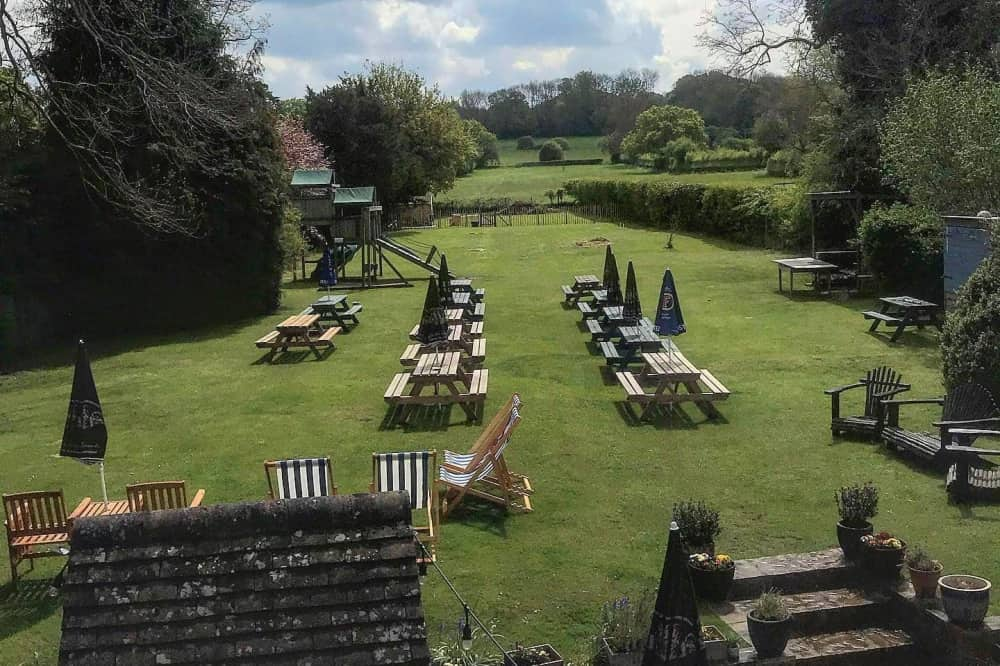 The Old Boot Stanford dingley Berkshire garden countryside views tables kids play area and deckchairs