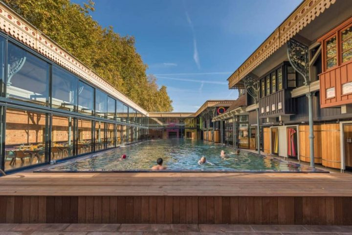 Thames Lido Edwardian swimming bath Reading with modern glass fronted restaurant infinity pool and hot tub