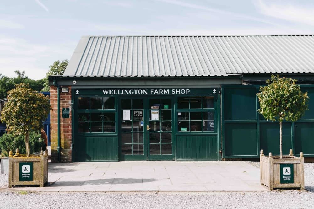 Wellington Farm Shop and Cafe dark green painted exterior Berkshire Hampahire border Wellington Estate