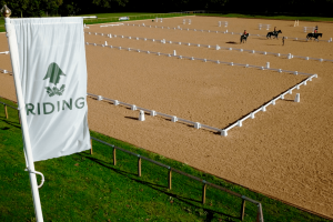 Wellington Riding large menage with white posts for schooling horses Berkshire Hampshire